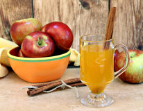 Apple cider with cinnamon sticks Royalty Free Stock Photography