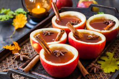 Apple cider. With cinnamon sticks and anise star in apple cups stock photos