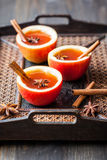 Apple cider. With cinnamon sticks and anise star in apple cups Stock Images