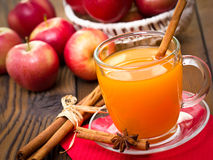 Apple cider with cinnamon sticks Stock Images