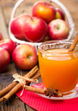 Apple cider with cinnamon sticks Royalty Free Stock Images