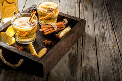 Apple cider cocktail. Autumn and winter drinks. Traditional home-made apple cider, cocktail of cider with aromatic spices - cinnamon and anise. On an old wooden royalty free stock images