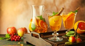 Free Apple Cider Cocktail With Red Oranges And Spices In Glasses And Jug On Table. Concept Of Autumn And Winter Drinks Royalty Free Stock Photo - 195203775