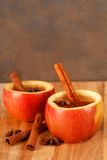 Apple cider in hollowed out apple Royalty Free Stock Images