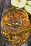 Apple cider with ice cubes Royalty Free Stock Photography