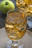 Apple cider with ice cubes Stock Photos