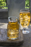 Apple cider with ice cubes Royalty Free Stock Images