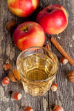 Apple cider or juice in a glass, close-up. Vertical Royalty Free Stock Images