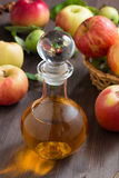 Apple cider or juice in a glass decanter Royalty Free Stock Images