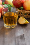 Apple cider or juice in a glass and space for text Royalty Free Stock Images