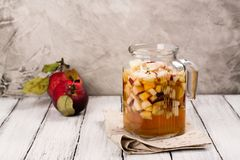 Apple cider sangria in a glass jar on wooden table Stock Images