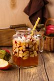 Apple cider sangria in a glass jar on wooden table Stock Photos