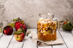 Apple cider sangria in a glass jar on wooden table Stock Photography