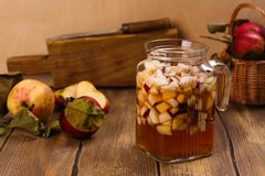 Apple cider sangria in a glass jar on wooden table Stock Photo
