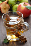 Apple cider with spices in glass cup, selective focus, top view Stock Photography