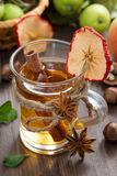 Apple cider with spices in glass mug, close-up Stock Images