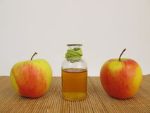 Apple cider vinegar and apples Stock Photography