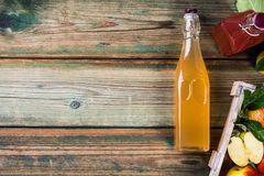 Apple cider vinegar and fresh apples Stock Photography