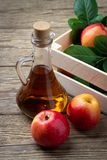 Apple cider vinegar and fresh red apple royalty free stock photos