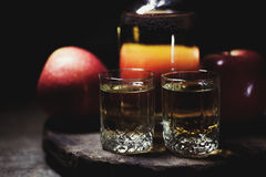 Apple cider vinegar in a glass jug, fresh apples, dark wooden ba Royalty Free Stock Photography