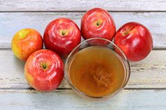 Apple cider vinegar with mother enzymes. Fresh apples and a bowl of raw and unfiltered organic apple cider vinegar with mother enzymes Stock Photo