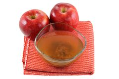 Apple cider vinegar with mother enzymes. Fresh apples and a bowl of raw and unfiltered organic apple cider vinegar with mother enzymes isolated on white Stock Photo