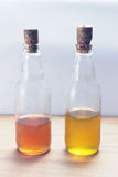 Apple cider vinegar and olive oil. In glass bottles Stock Photography
