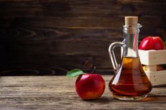 Apple cider vinegar and red apple stock photos