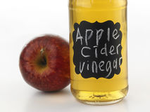 Apple cider vinegar. On the white background Royalty Free Stock Photography