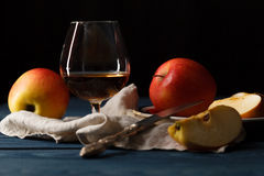 Apple cider in wine glass with cinnamon sticks and fresh apples Stock Image