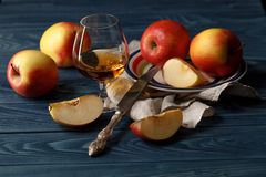 Apple cider in wine glass with cinnamon sticks and fresh apples Royalty Free Stock Photo