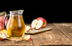 Apple Cider on wooden background selective focus Royalty Free Stock Photography