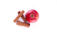 Apple with cinamon. Red apple with raw cinamon Stock Images
