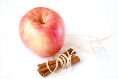 Apple with cinnamon. One apple white the cinnamon Royalty Free Stock Photography