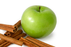 Apple and cinnamon. Granny smith green apple with cinnamon sticks Royalty Free Stock Image