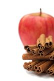 Apple & Cinnamon. On white - shallow dof royalty free stock image