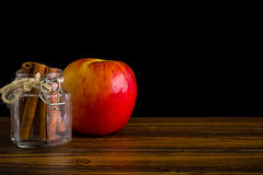 Apple with Cinnamon Background / Apple with Cinnamon / Apple with Cinnamon on Black Background Royalty Free Stock Photo