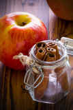 Apple with Cinnamon Background / Apple with Cinnamon / Apple with Cinnamon on Wooden Background Royalty Free Stock Images