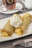 Apple cinnamon crepe. With ice cream Royalty Free Stock Images