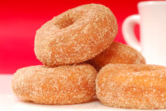 Apple cinnamon doughnuts with coffee Stock Image