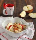 Apple-cinnamon oatmeal with pecans Royalty Free Stock Image