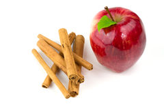 Apple and cinnamon sticks Royalty Free Stock Photos