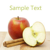 Apple and cinnamon sticks Stock Photos