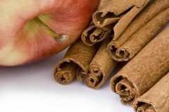 Apple and cinnamon sticks Royalty Free Stock Photo