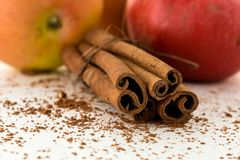 Apple and cinnamon sticks chocolate chip. Food crumb ingredient aroma aromatic sweet red brown cooking eat macro dessert fresh decoration apples juicy healthy royalty free stock photo