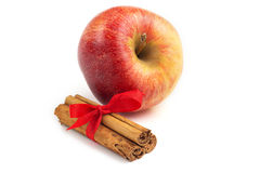 Apple and cinnamon sticks Royalty Free Stock Images