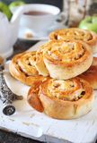 Apple and cinnamon sweet buns and cup of tea royalty free stock images