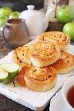Apple and cinnamon sweet buns, green apples and cup of tea stock photos