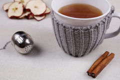 Apple cinnamon tea. Hot drink for cold winter and fly, warmth concept, cozy mug Stock Image
