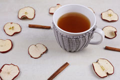Apple cinnamon tea. Hot drink for cold winter and fly, warmth concept, cozy mug Royalty Free Stock Photo